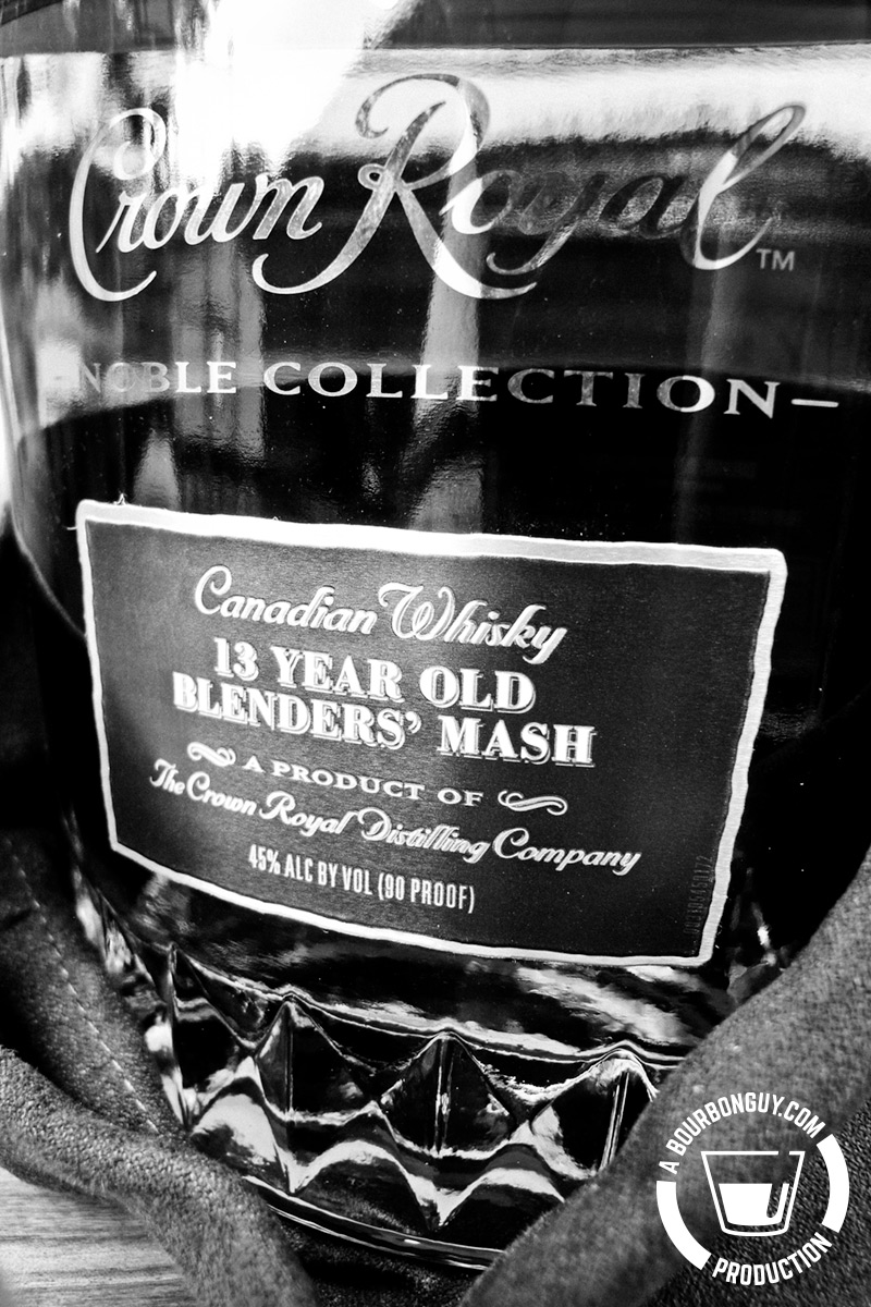 IMAGE: The front of a bottle of Crown Royal Noble Collection: 13 Year Old Blender's Mash. the bag is gathered around the base of the bottle.
