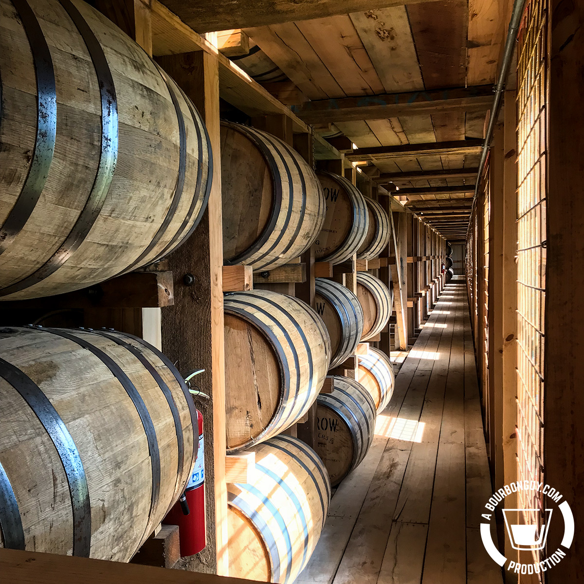 IMAGE: A view down the side hall of the Lux Row aging warehouse. Barrels in the foreground.