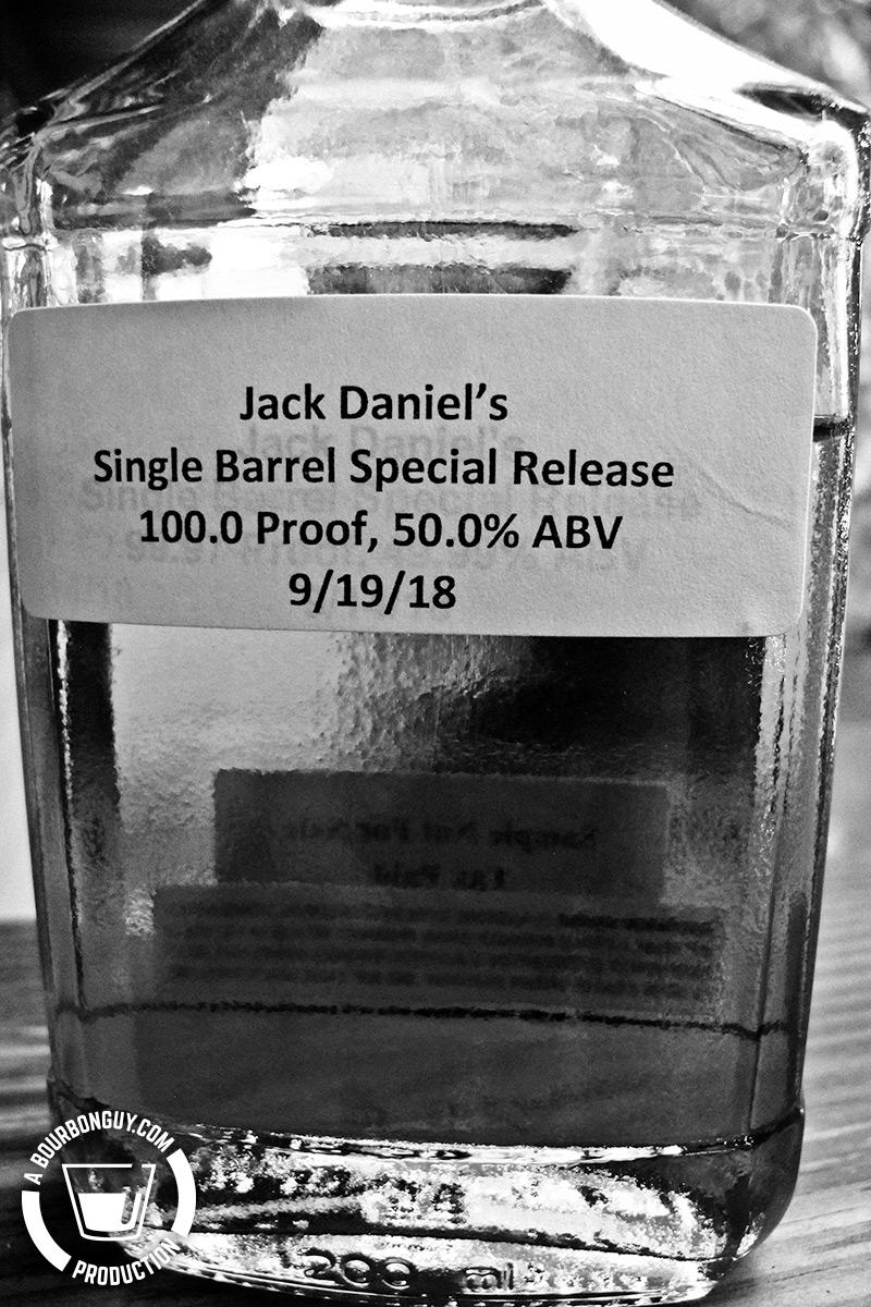 """IMAGE: Review sample bottle of Jack Daniel's Single Barrel Heritage Barrel. It is a plain bottle with a laser printed, paper label stating: """"Jack Daniel's Single Barrel Special Release. 100.0 Proof, 50.0% ABV. 9/19/18"""""""