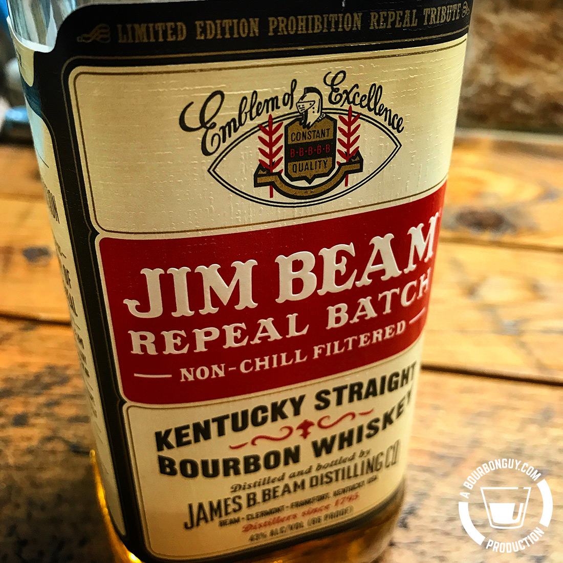"""IMAGE: The front label of Jim Beam Repeal batch. Copy says (from top to bottom): """"Limited Edition Prohibition Repeal Tribute. Emblem of Excellence. Jim Beam Repeal Batch. Non-Chill Filtered. Kentucky Straight Bourbon Whiskey. Distilled and bottled by James. B. Beam Distilling Co. Beam • Clermont • Frankfort, Kentucky USA. Distillers since 1795. 43% ALC/Vol (86 proof)"""""""
