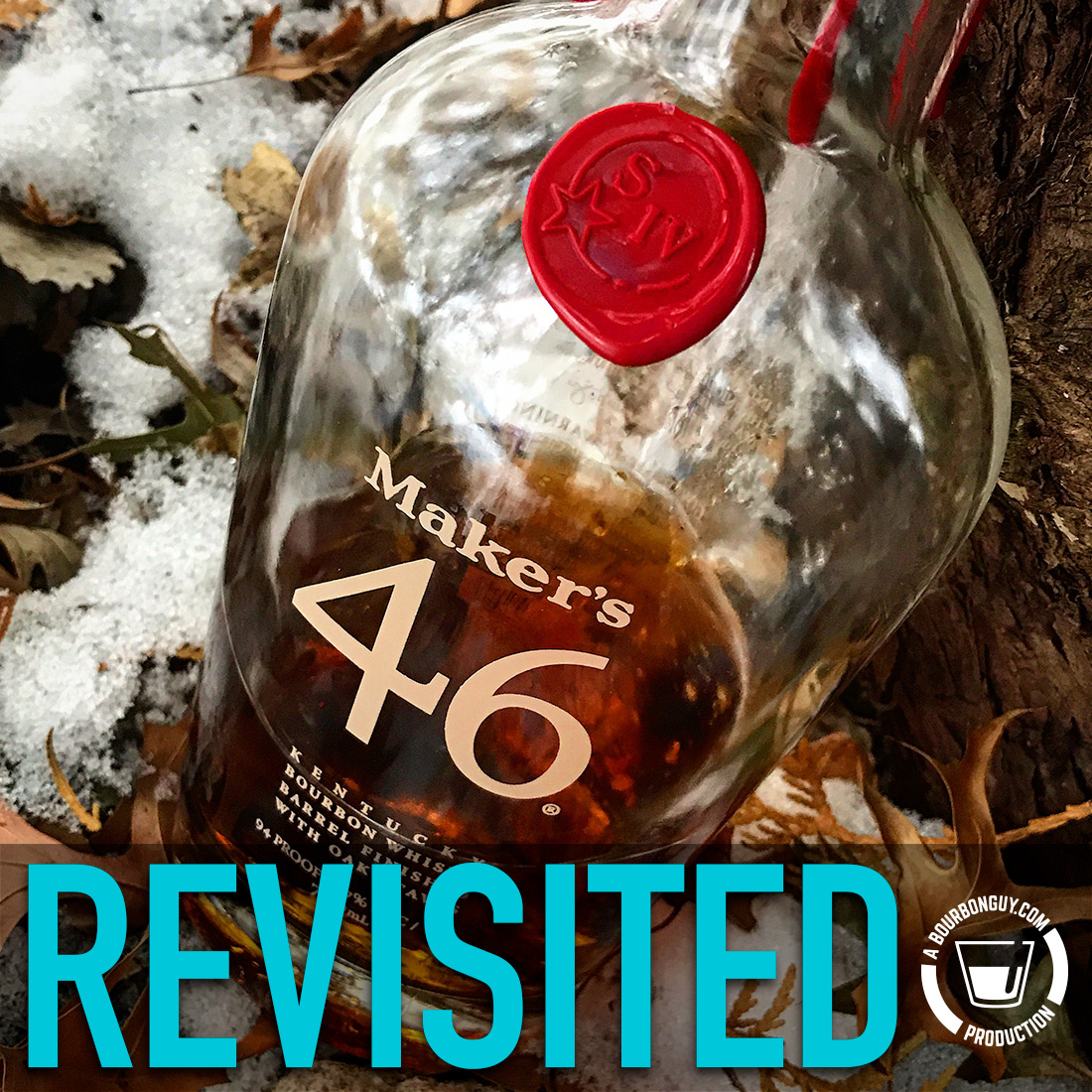 IMAGE: A bottle of Maker's 46 sitting in light snow over leafy ground while leaning against a tree.