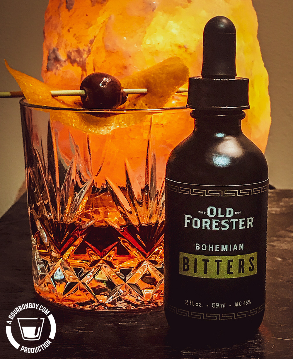IMAGE: An old fashioned and a bottle of Old Forester Bohemian Bitters