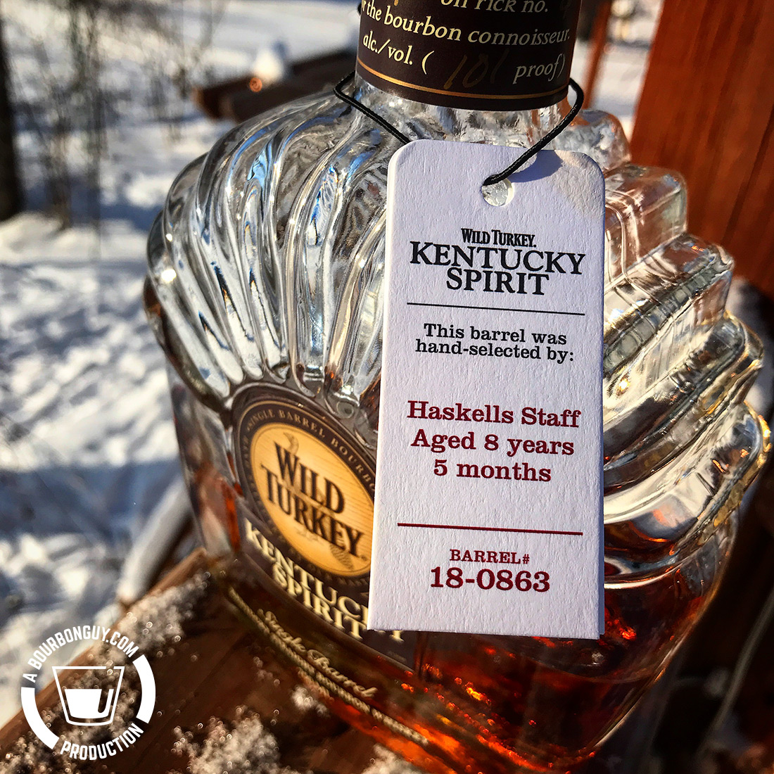 IMAGE: Neck tag hanging from a bottle of Wild Turkey Kentucky Spirit. Tag states the bourbon was aged 8 years and 5 months.