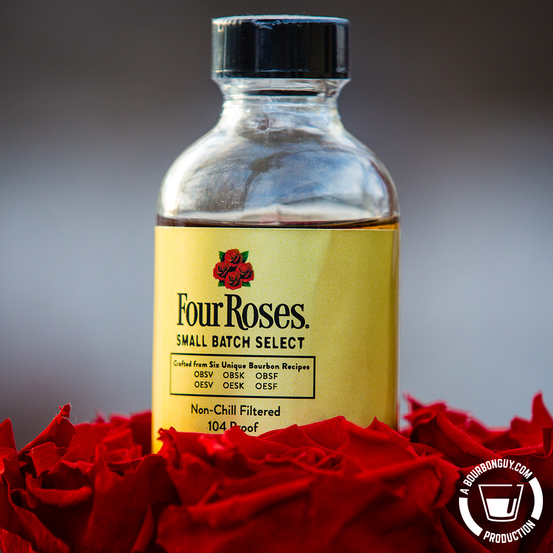IMAGE: A sample bottle of Four Roses Small Batch Select sitting in a bouquet of roses