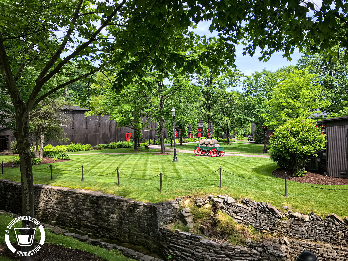 IMAGE: The green grass and black buildings of the Maker's Mark Campus.