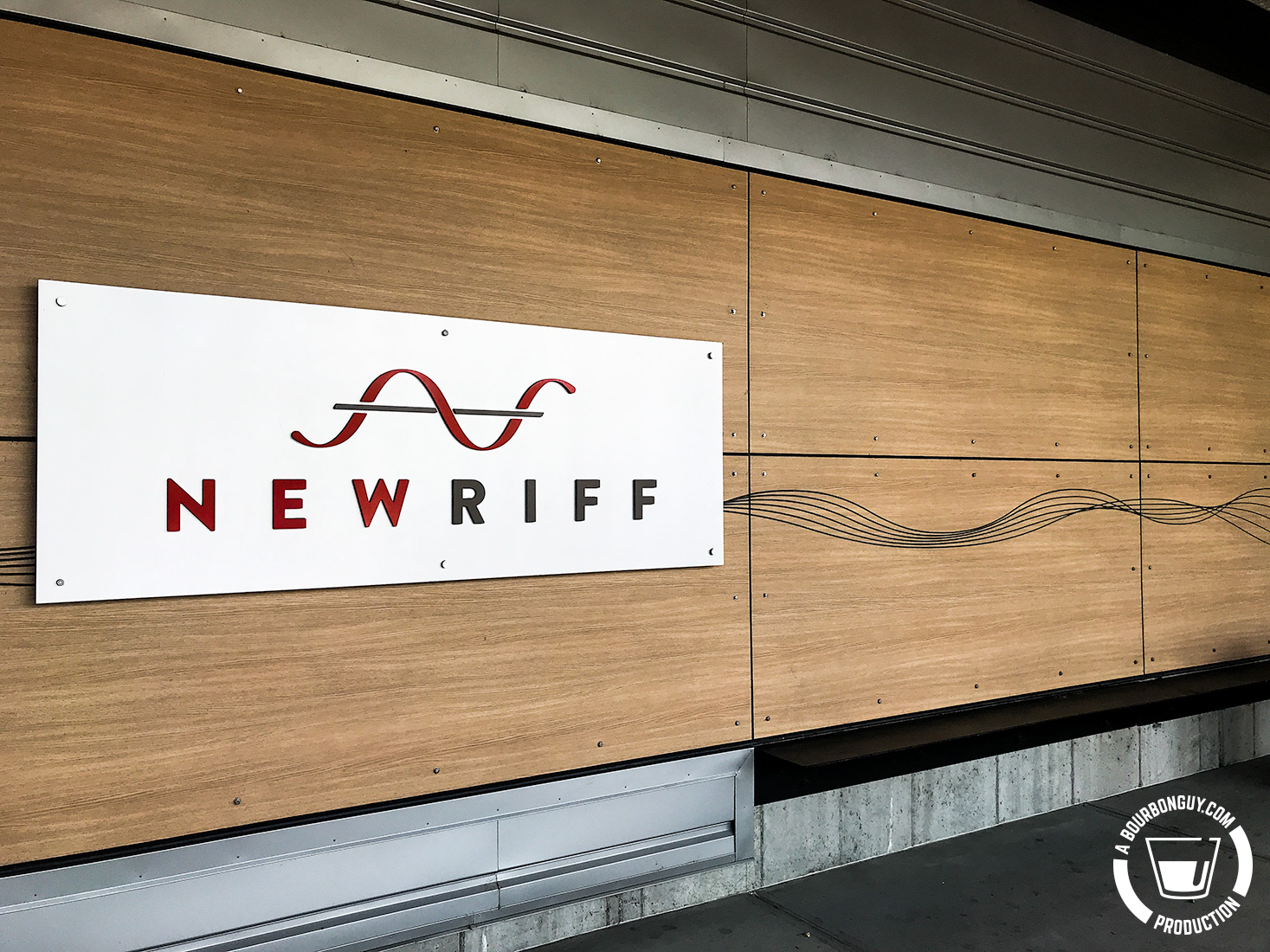 IMAGE: The Front entry of New Riff Distillery. New Riff logo with sound waves emanating from it.