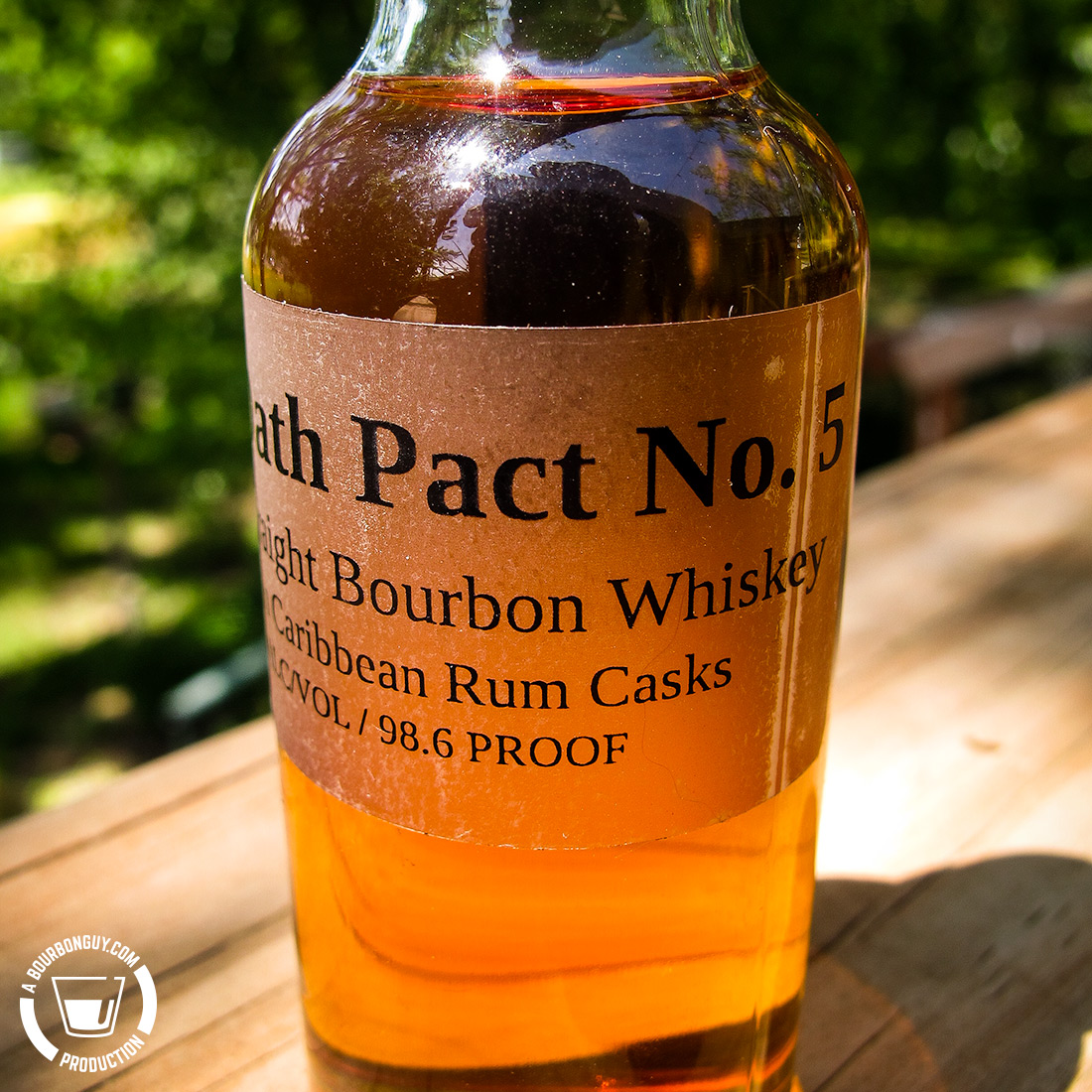 "IMAGE: A close up image of a 50mL sample bottle with the words ""Blood Oath Pact No. 5, Straight Bourbon Whiskey finished in Caribbean Rum Casks. 49.3% ABV / 98.6 proof"""