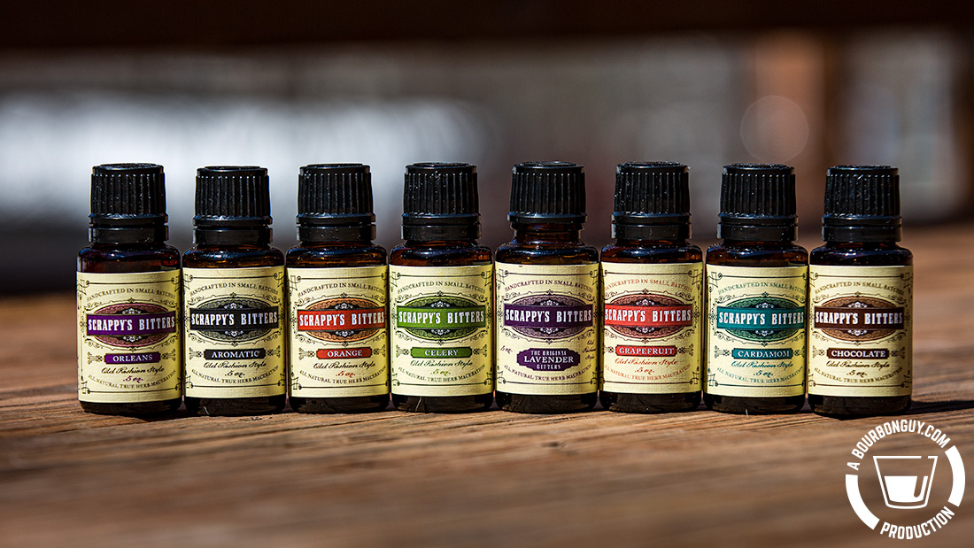 IMAGE: Miniature bottles of Scrappy's Bitters. Orleans (a Peychaud's knockoff), Aromatic, Orange, Celery, Lavender, Grapefruit, Cardamom, and Chocolate flavors.