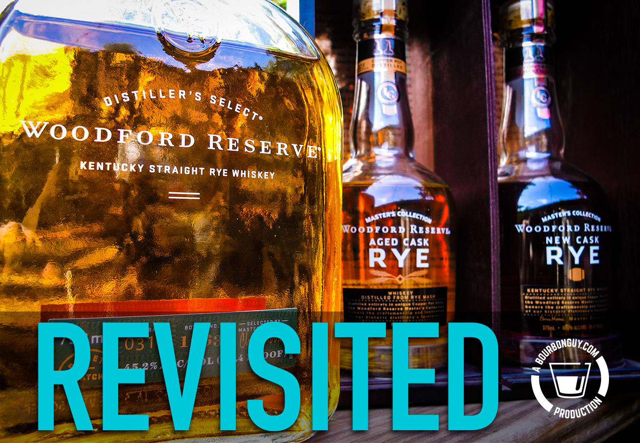 IMAGE: Three bottled os rye whiskey. The foreground has Woodford Reserve Rye. In the background are the two bottles of the Woodford Reserve Master's Collection Rare Rye release, one aged in a used cask and one aged in a new cask.