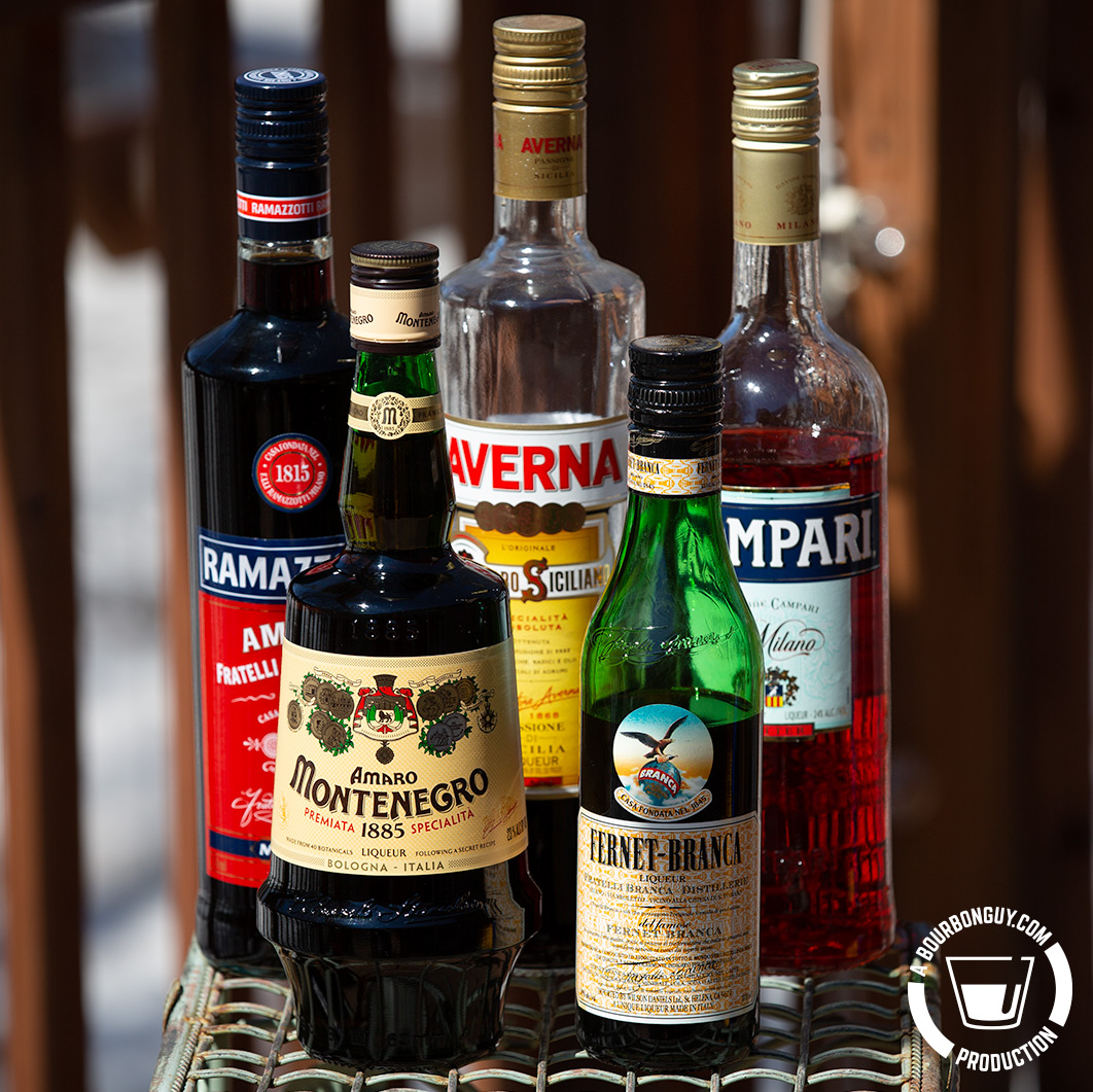 IMAGE: A grouping of random amaros including: Amaro Montenegro, Averna, Ramazzotti, Campari, and Fernet-Branca.