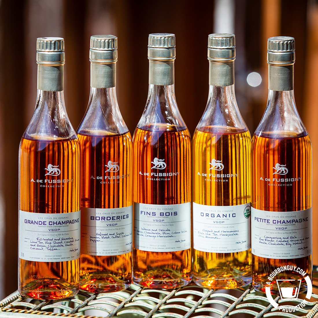 IMAGE: five cognacs from the A. de Fussigny Cognac Collection. One from four different cognac regions and one organic blend