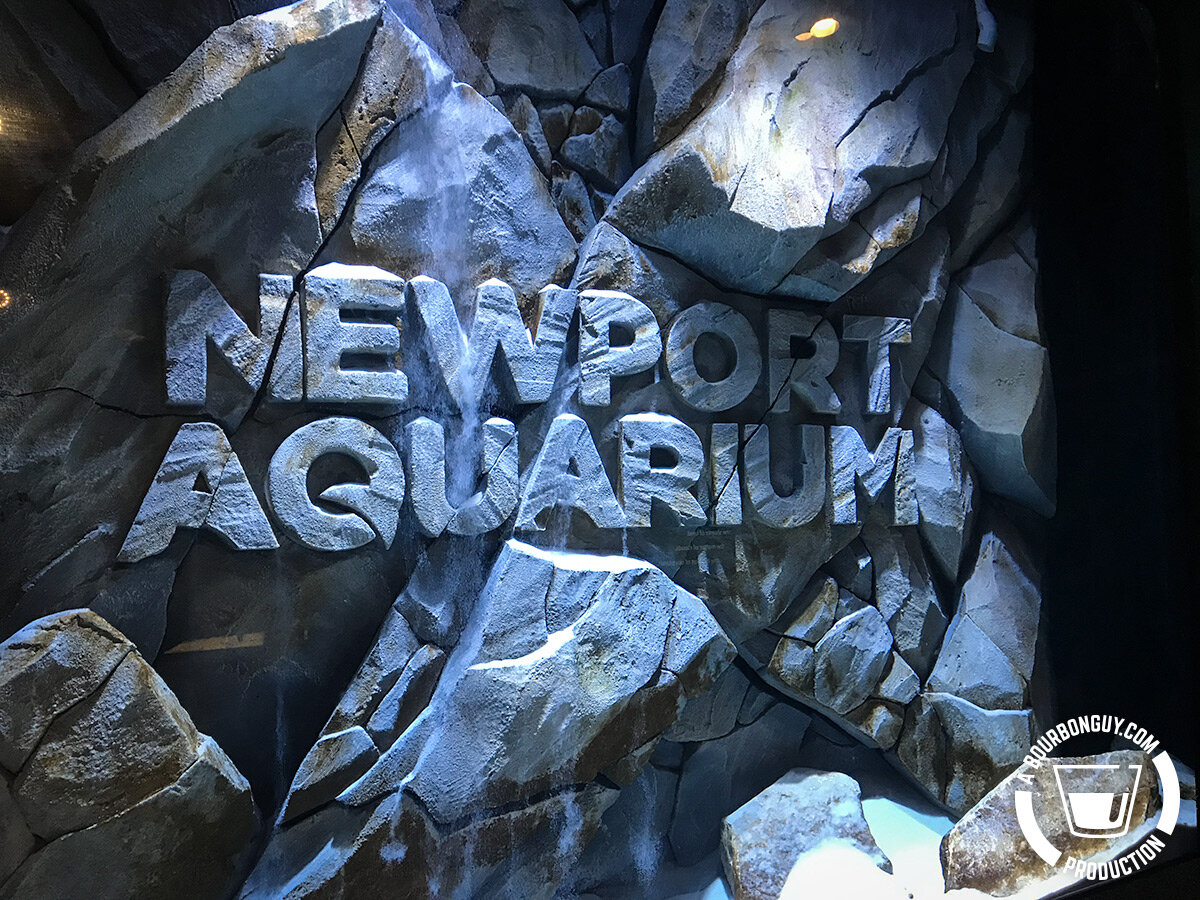 IMAGE: Sand flowing down to land on the underwater logo fo the Newport Aquarium in Newport, KY.