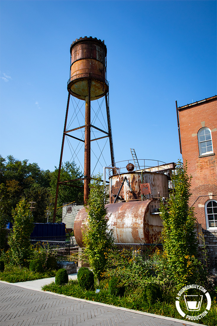 IMAGE: A rusting water tower and holding tanks overlook the plaza that leads to the gift shop, cocktail bar, springhouse and botanical garden.
