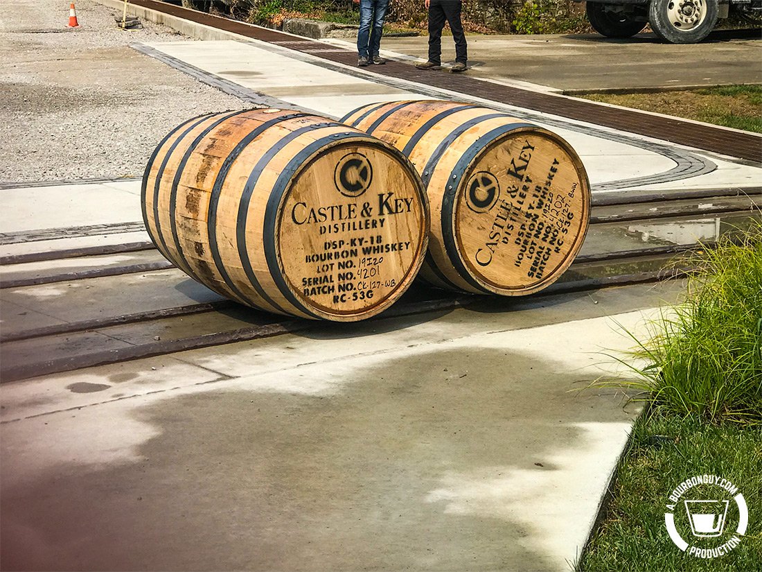IMAGE: Two recently filled barrels waiting to be rolled to a warehouse for aging