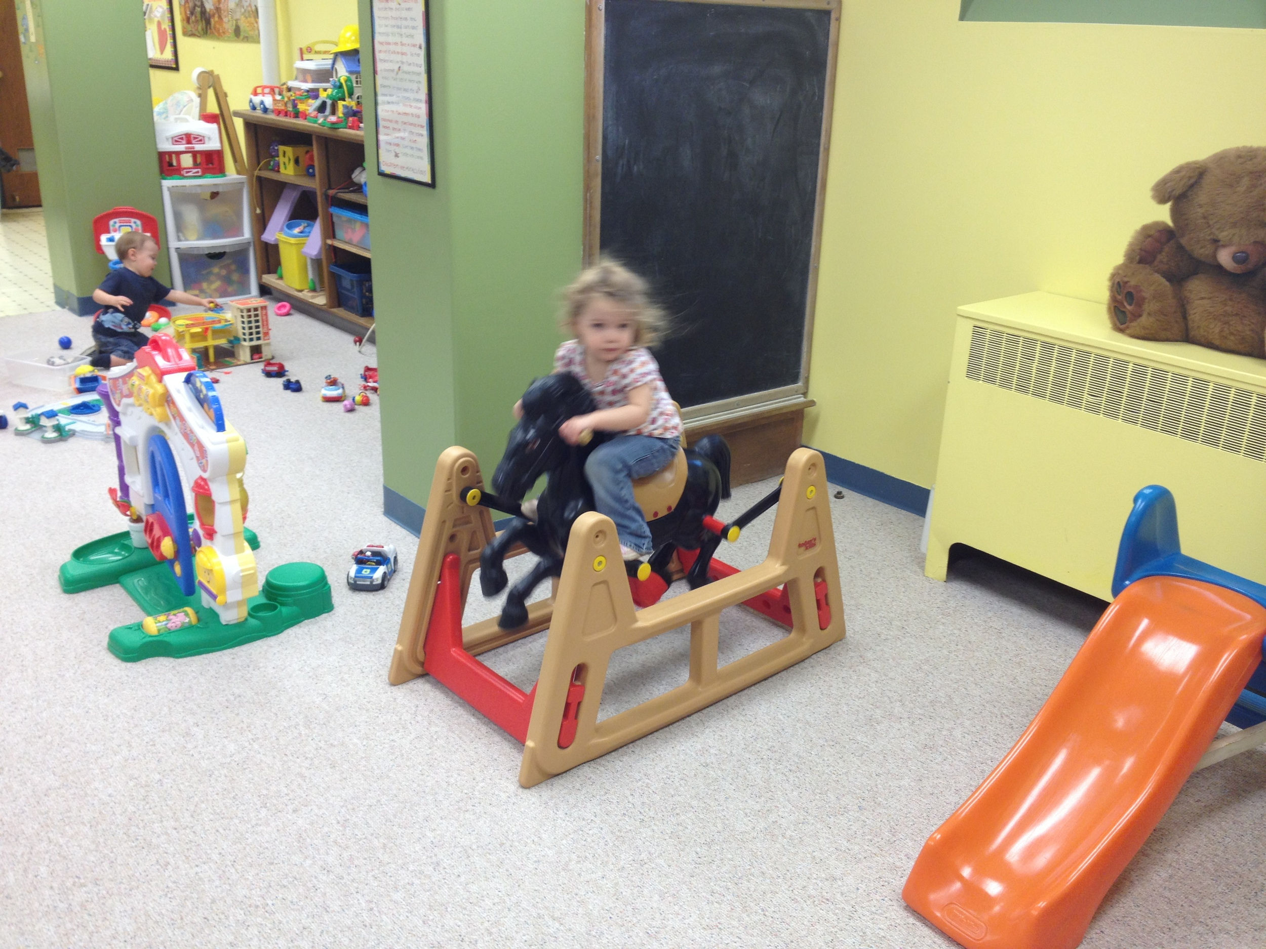 Maddie spending some quality time in the nursery. Pardon the blur she was really giving the horse a workout.