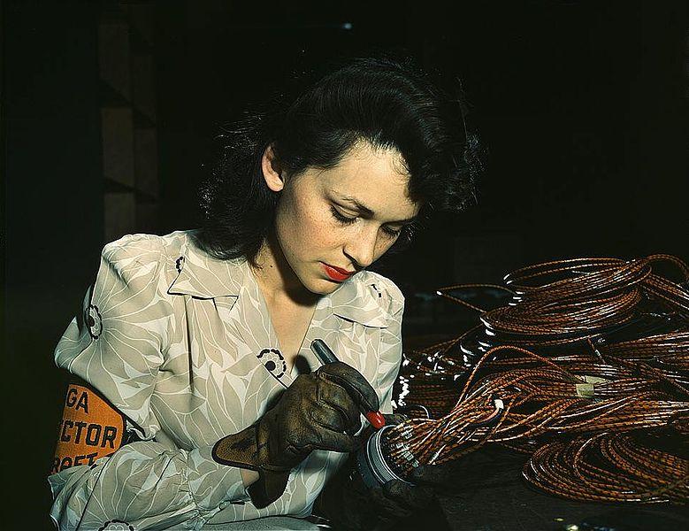 779px-Woman_aircraft_worker,_Vega_Aircraft_Corporation,_Burbank,_Calif._Shown_checking_electrical_assemblies_(LOC)