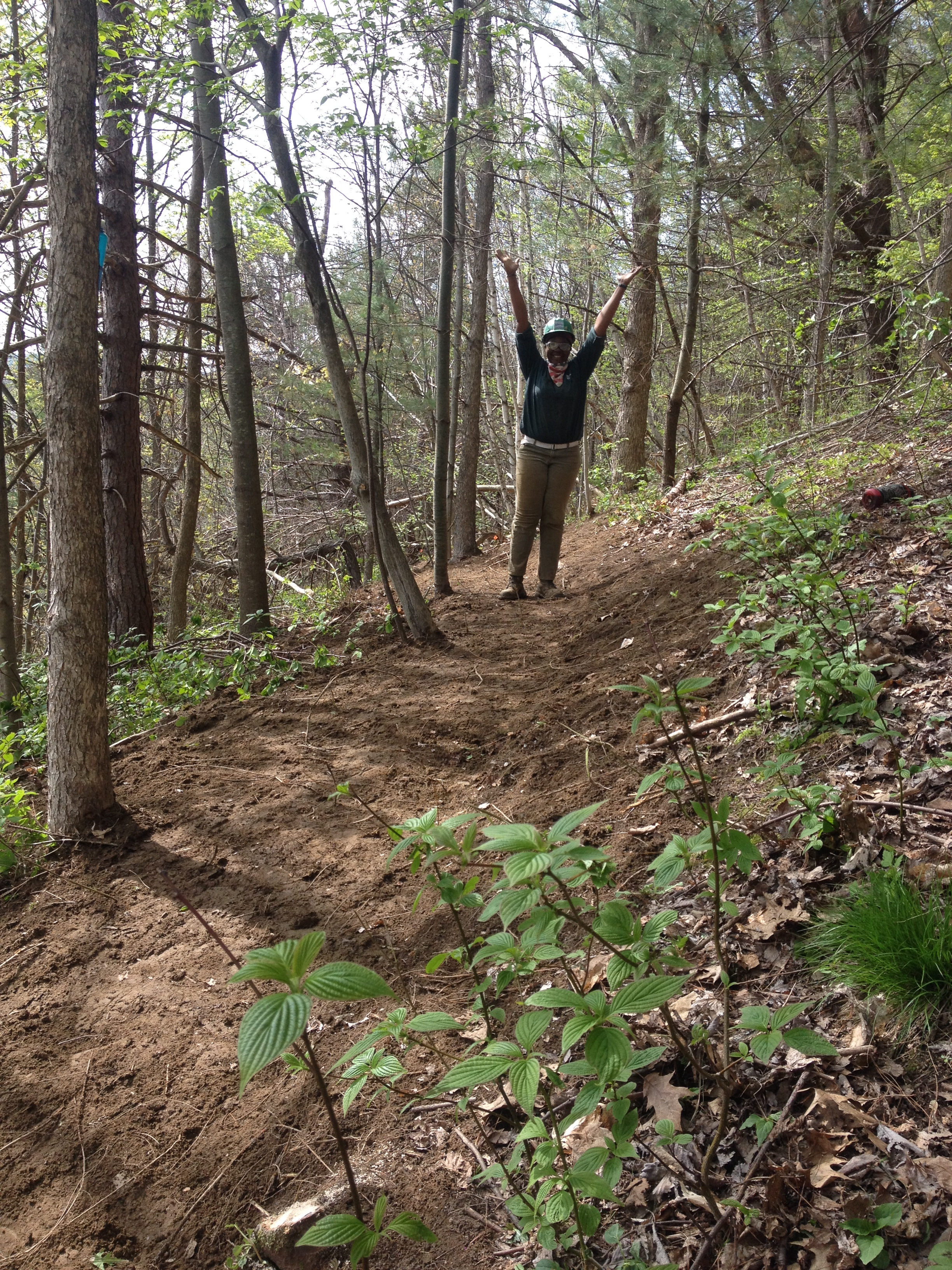 Katheryne Lewis on freshly benched trail at Vermont Youth Conservation Corps in Richmond, Vermont.
