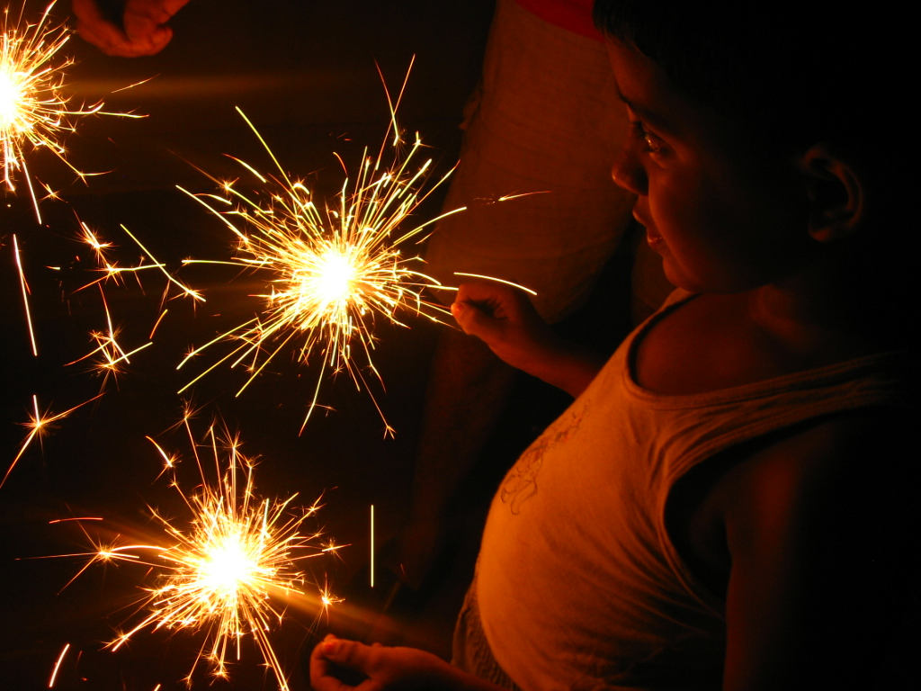 Boy_with_sparklers_-_Diwali.jpg