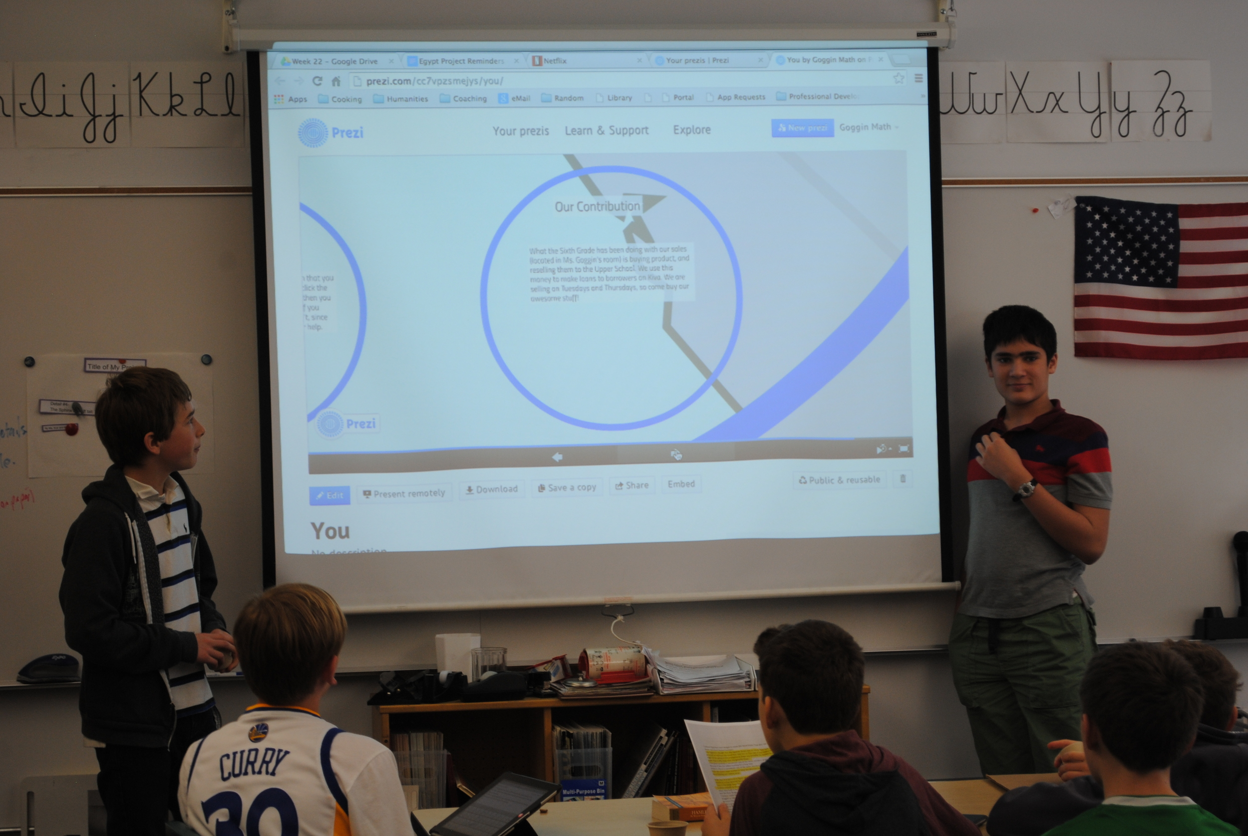 6th grade peers learn about micro lending.