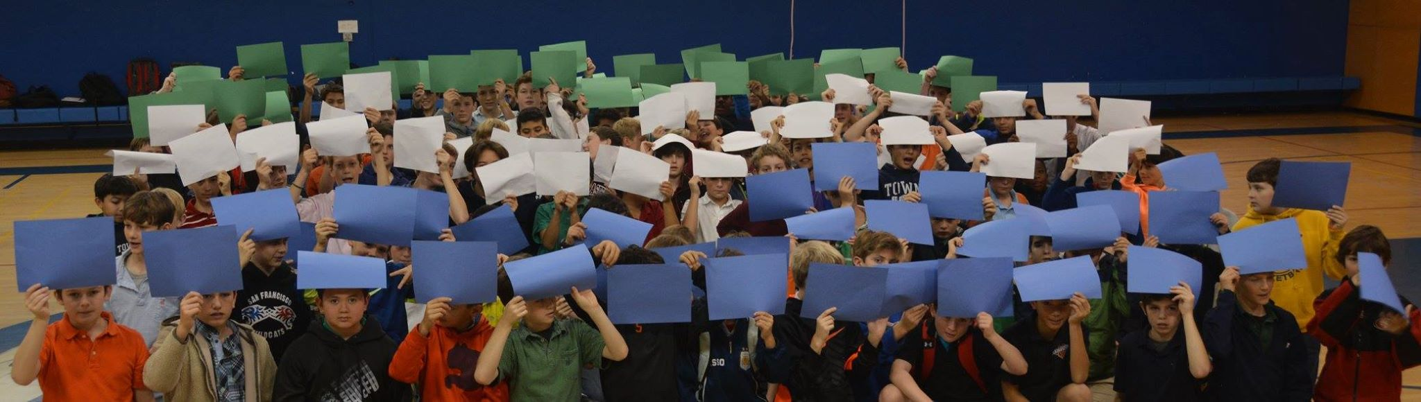Solidarity with our friends in Sierra Leone.  5th, 6th and 8th graders make a human flag.