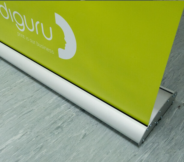 Table Top Banner Stands - Each table top pull up banner comes in its own table top retractable banner stand. These small but sturdy stands are made from lightweight aluminum and have chrome-effect end caps.