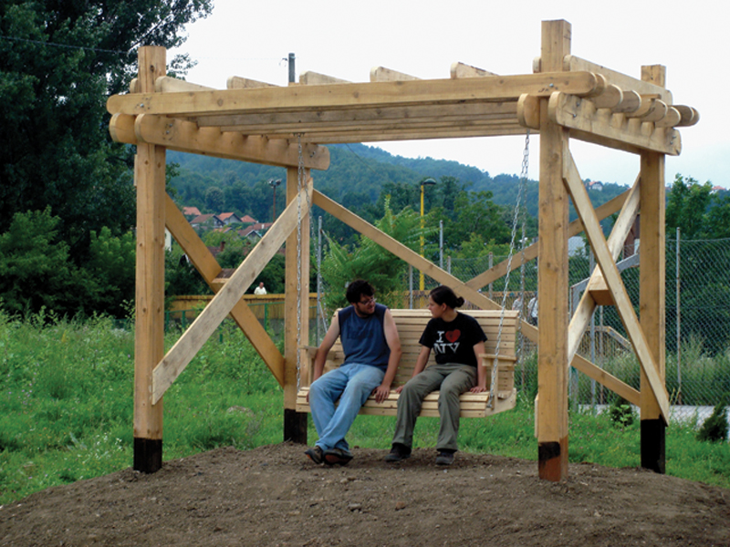 Mound with Pergola and Bench Swing
