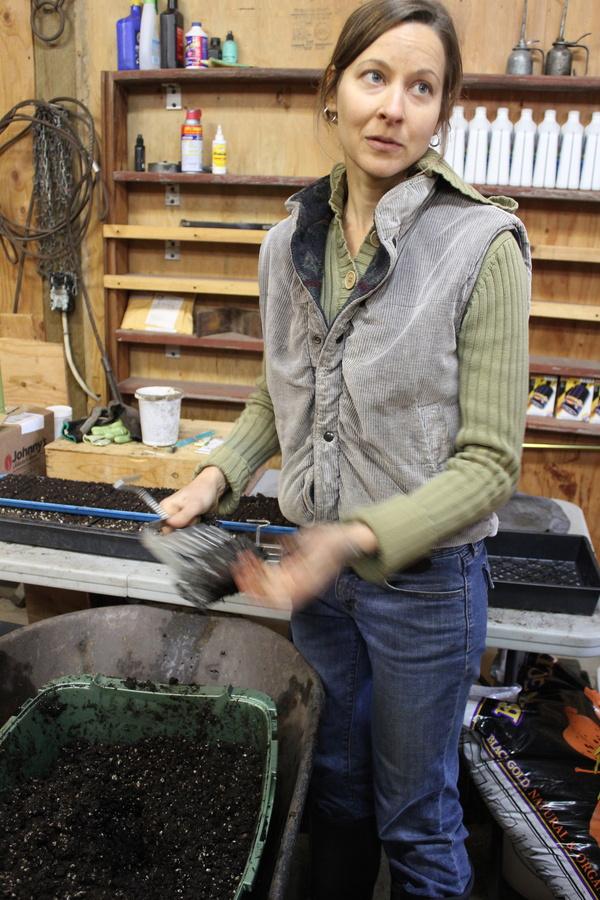 Michelle demonstrates soil block making for seedlings