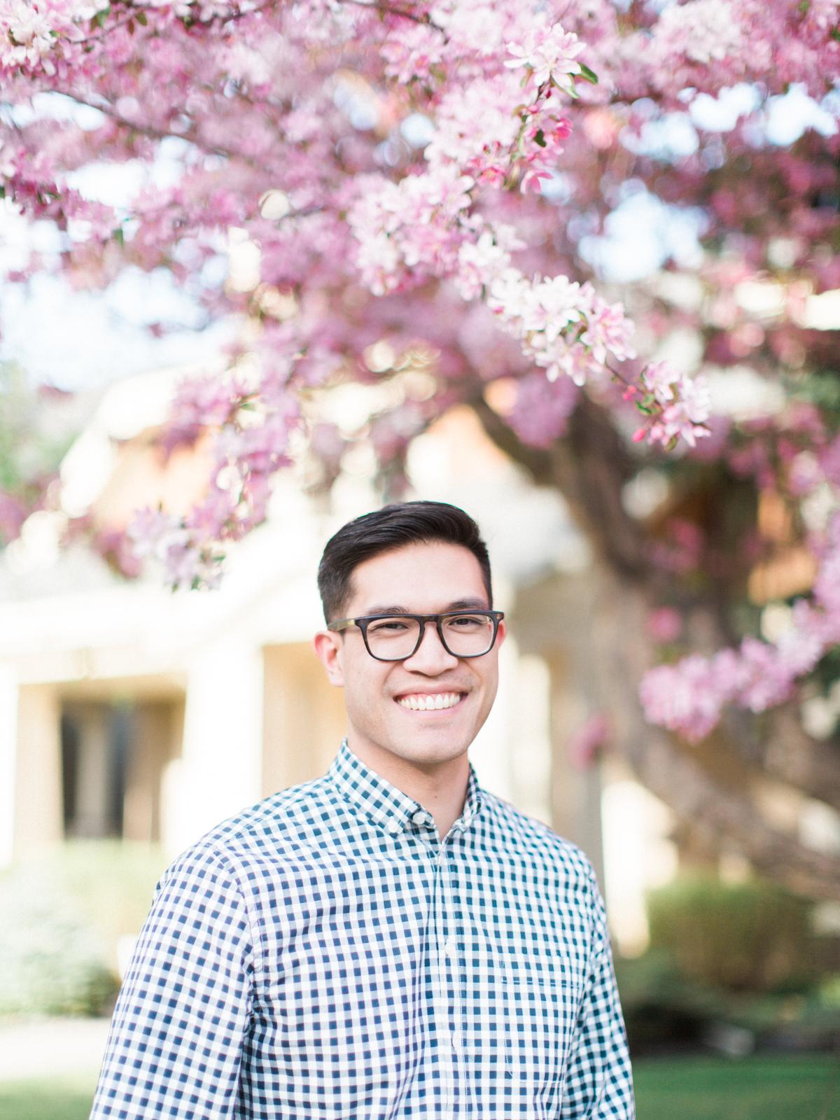 Calgary-wedding Photography-spring-engagement-cherry-tree-guy.jpg
