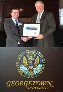 (L-R) David Shearman, Veterans Office Coordinator at Georgetown, is presented an Aurora certificate by Aurora President Tom DeWitt.