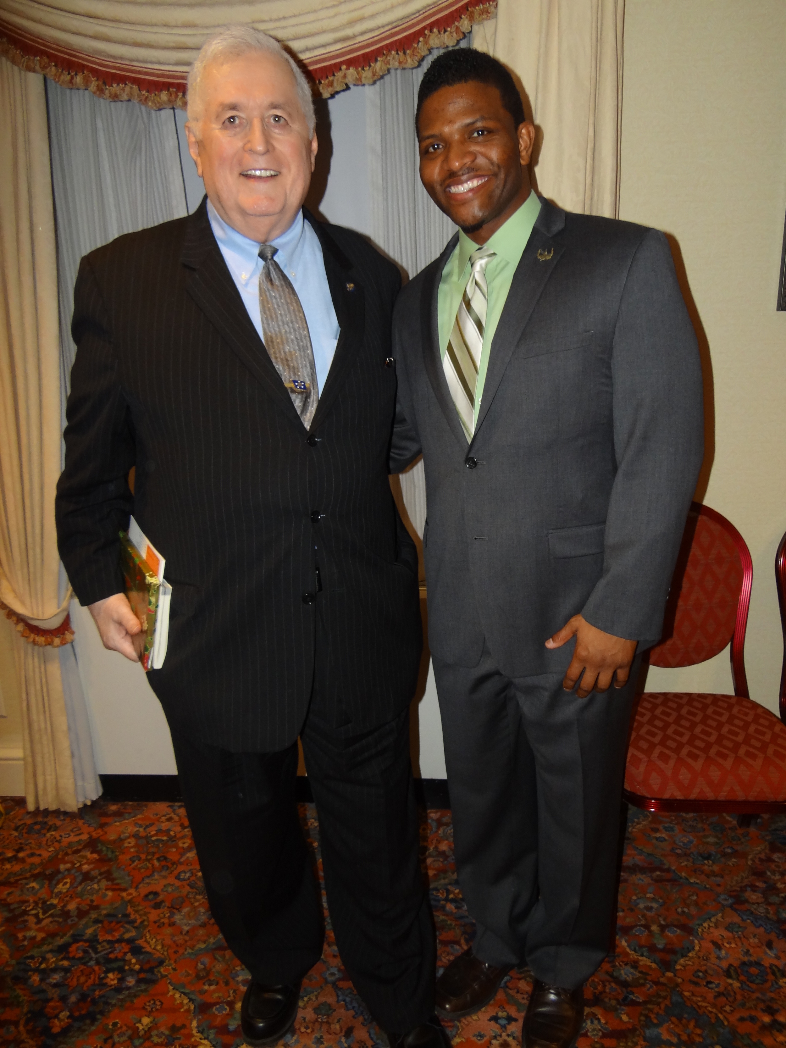 RADM Carey, Founder of the Washington Scholars, and K.N. Barrett, USMC and intern with Reserve Officers Association.