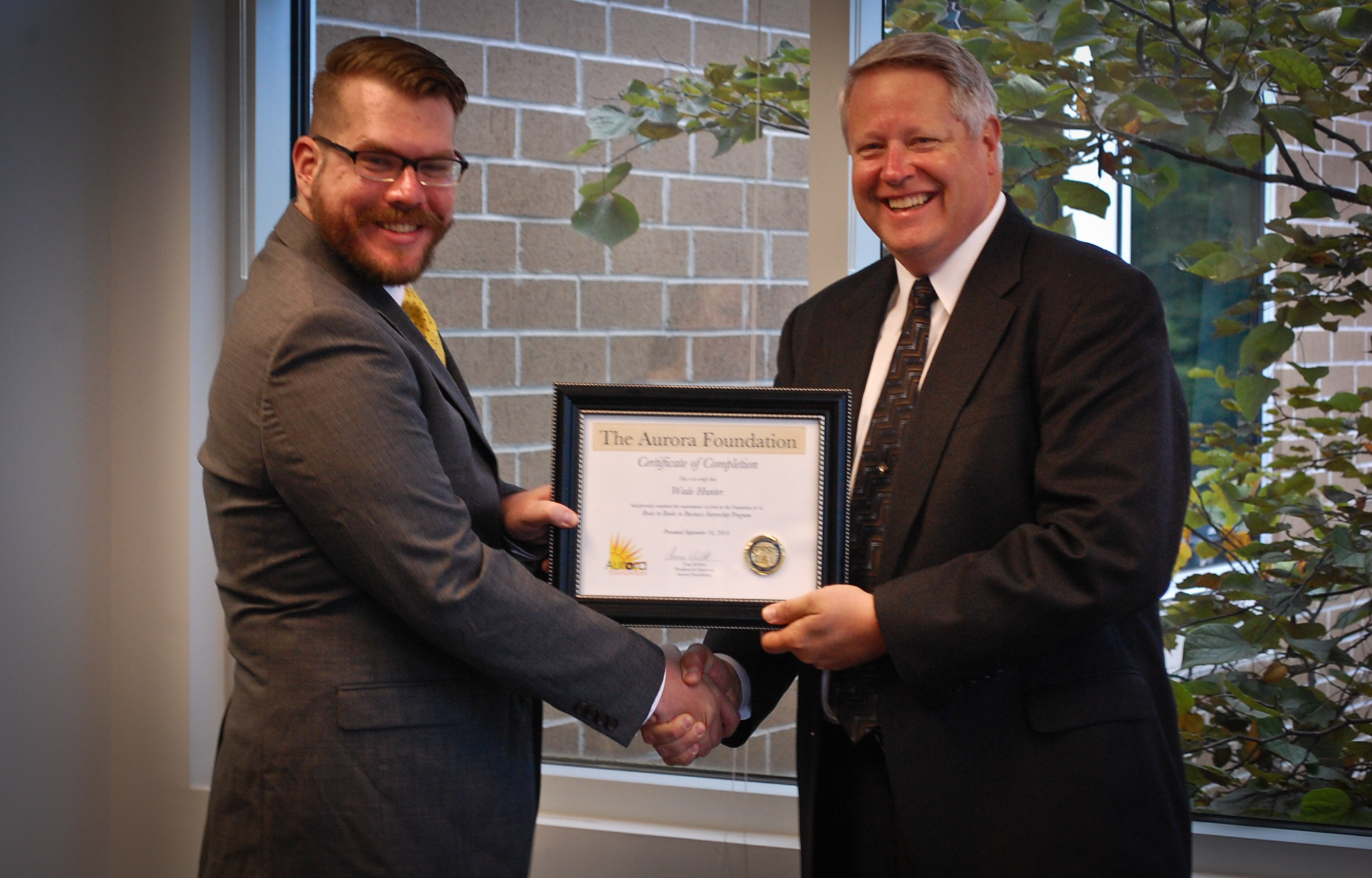 Wade Hunter accepting his Certificate of Completion from Aurora's Chairman, Tom DeWitt