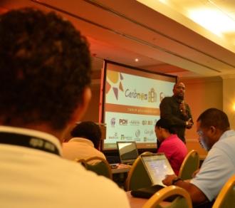 CAPTION:    Junior Mc Intyre, head of Caribbean Telecommunications Union's Caribbean Regional Communications Infrastructure Program coordination unit, addresses regional tech experts during CaribNOG 8, Hilton Curacao, Willemstad, October 1. PHOTO: GERARD BEST