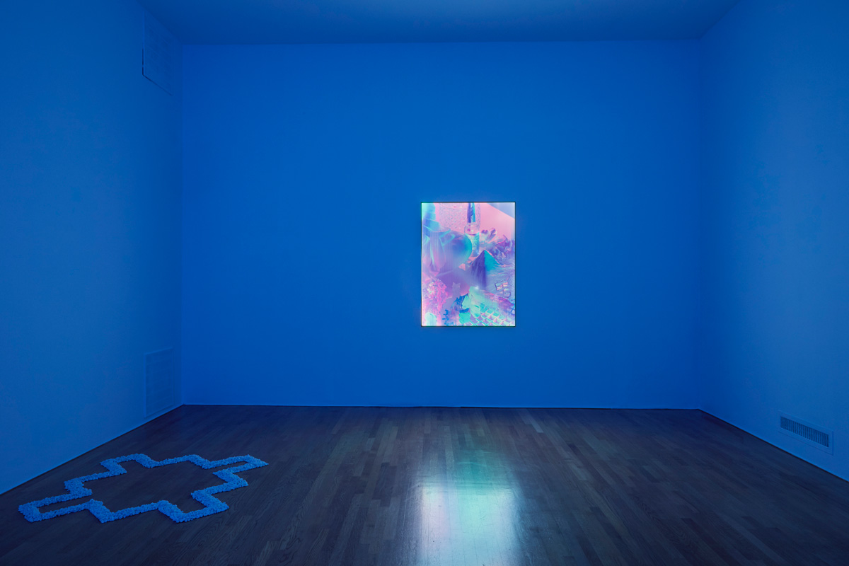 ////  ROOM 03 - Lenticular light panel that appears to change colour, and an altar-like arrangement of pebbles.