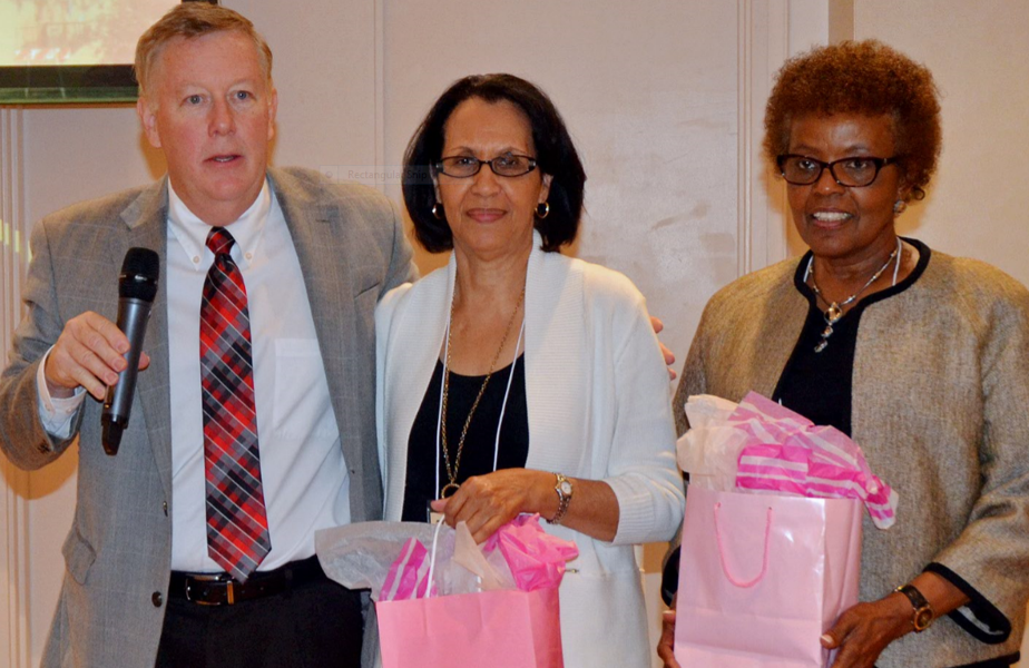 Rev. Dr. Woodie rea recognizes sharon boone and louise Langley for their efforts to coordinate the brunch.