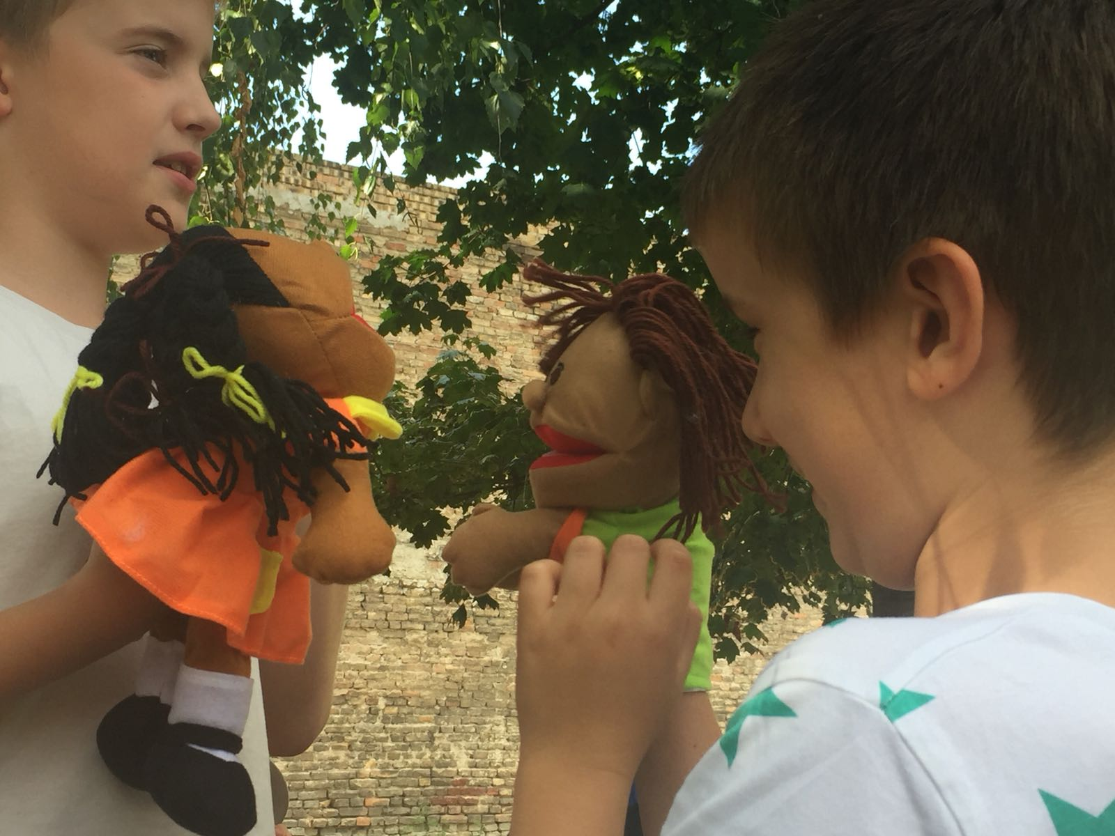 Missionary Jones sent these pictures to show that the children continue to enjoy playing with the puppets.