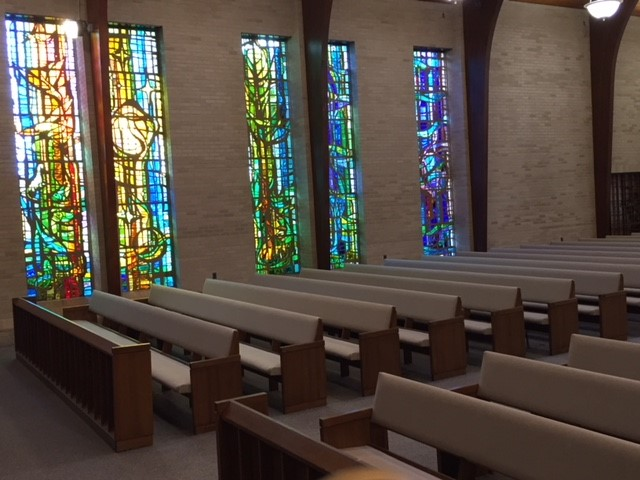 Stained glass 5 with pew at angle.jpg