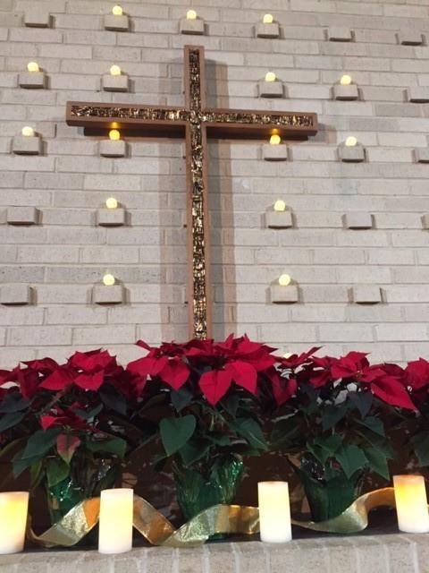 Poinsettias on altar 2.jpg