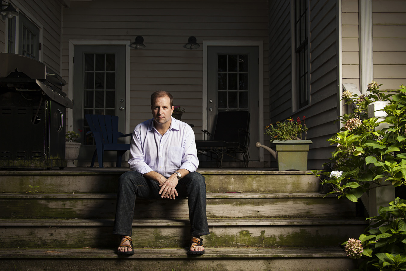 Kinnon sitting on the wood steps of his Midtown Mobile, AL home | Todd Douglas Photography