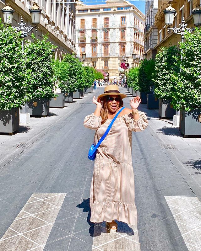 """Granada Oh Na Na⠀ ⠀ Half of my heart is in Granada⠀ Take me back to East Granada⠀ Oh, but my heart is in Granada (ay)⠀ There's somethin' 'bout his manners (uh huh)⠀ Granada ooh na-na (uh)⠀ ⠀ As you can see, my heart is genuinely in Granada, Spain. I absolutely love this city. Incredibly, the people are so friendly, and I can see myself drifting here for a few months. ⠀ ⠀ The smile on my face is authentic. The joy is real, and the peace passes all understanding. ⠀ ⠀ One quick story... We met an amazing young woman who wanted to share some native wines. You know I was gained and ready to taste away. Anywho, she took us to her friend's restaurant a small quaint place but based on the number of people who knew about the unassuming place we were in for a treat.  It's customary for restaurants to give you free tapas in Granada, and she was very generous, by giving us more than our deserving share. Then all began to happen, the wine has started to flow, and the conversations and parties immersed. ⠀ ⠀ Hi Best Friend, Sister, Girlfriend! ⠀⠀ ⠀ Continue to spread more love,⠀⠀⠀⠀ ⠀⠀⠀ I'm Andrea, ⠀⠀⠀⠀⠀ Your Girlfriend Next Door®️ come along with me as I share a new lifestyle guide to connect with girlfriends around the globe. It is a place for women to unite, get inspired, and share wisdom. ⠀ ⠀⠀ My motto as a """"Happy Girl"""" has literally taken  flight. I have dedicated myself to live a purposeful, fulfilled and happy life.⠀⠀ ⠀⠀ Friends That Travel Together Stay. Book your next trip with YGND Travel ⠀⠀ ⠀⠀ YourGirlfriendNextDoor #DarlingEscapes #GirlsWhoTravel #mothersday⠀⠀⠀ #TravelGram #LoveToTravel #TravelDiary #ViewFromTheTop⠀⠀⠀⠀⠀⠀⠀ #SimplyAdventure #Travelagency #WeAreTravelGirls #DameTraveler #FlashesofDelight #OpenMyWorld #WheretoFindMe #Travelagent #BeautifulDestinations #TravelInBetween #SheIsNotLost #WeAreTravelGirls⠀⠀⠀⠀⠀⠀ #FemmeTravel #GirlsAbroad #Girlsborntotravel #GirlAroundWorld #TravelGirlsGo #TheTravelWomen #GirlDiscoverers #GlobelleTravels #TheFairytaleBloggers #Girl"""