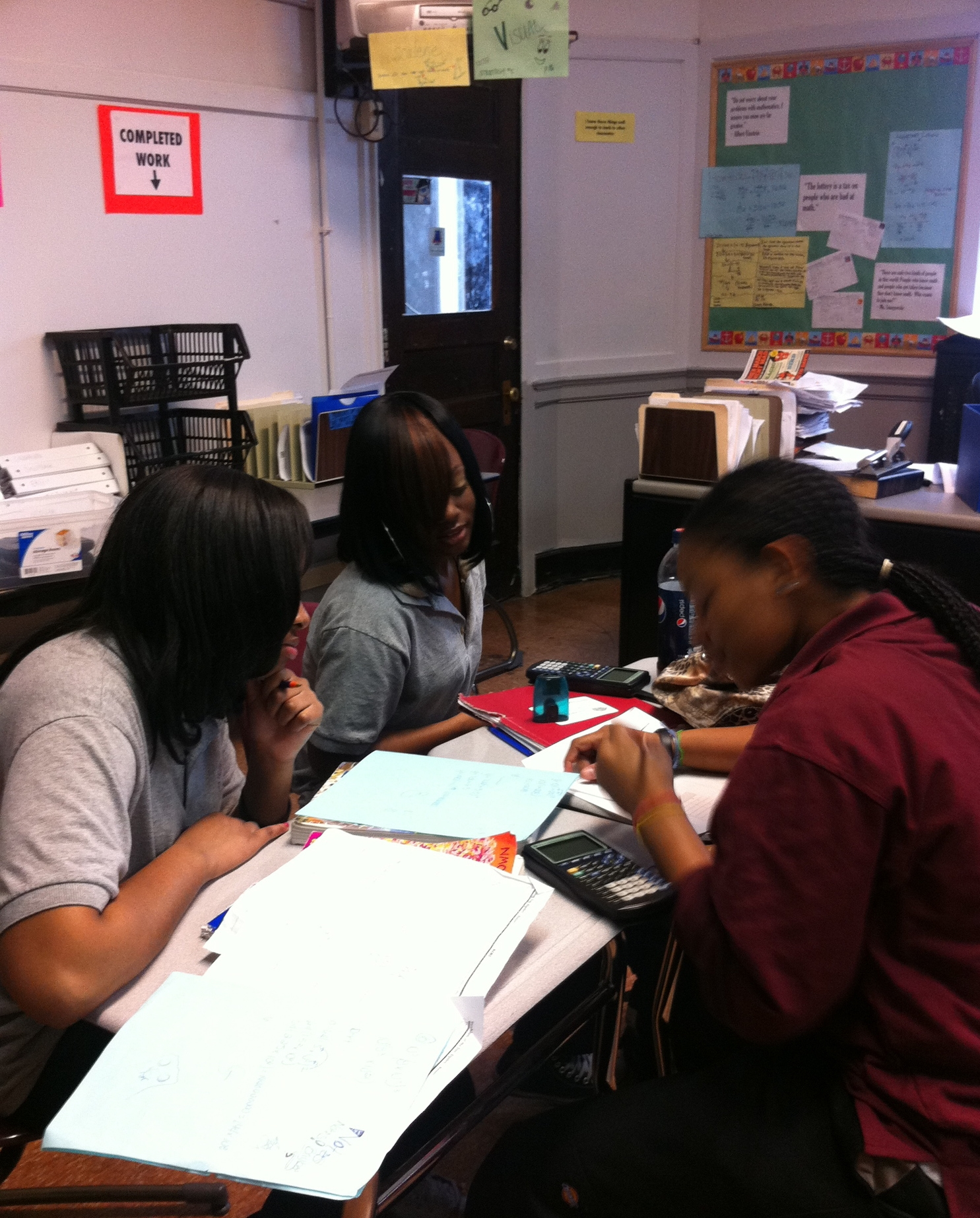 10th grade students collaborating in a group
