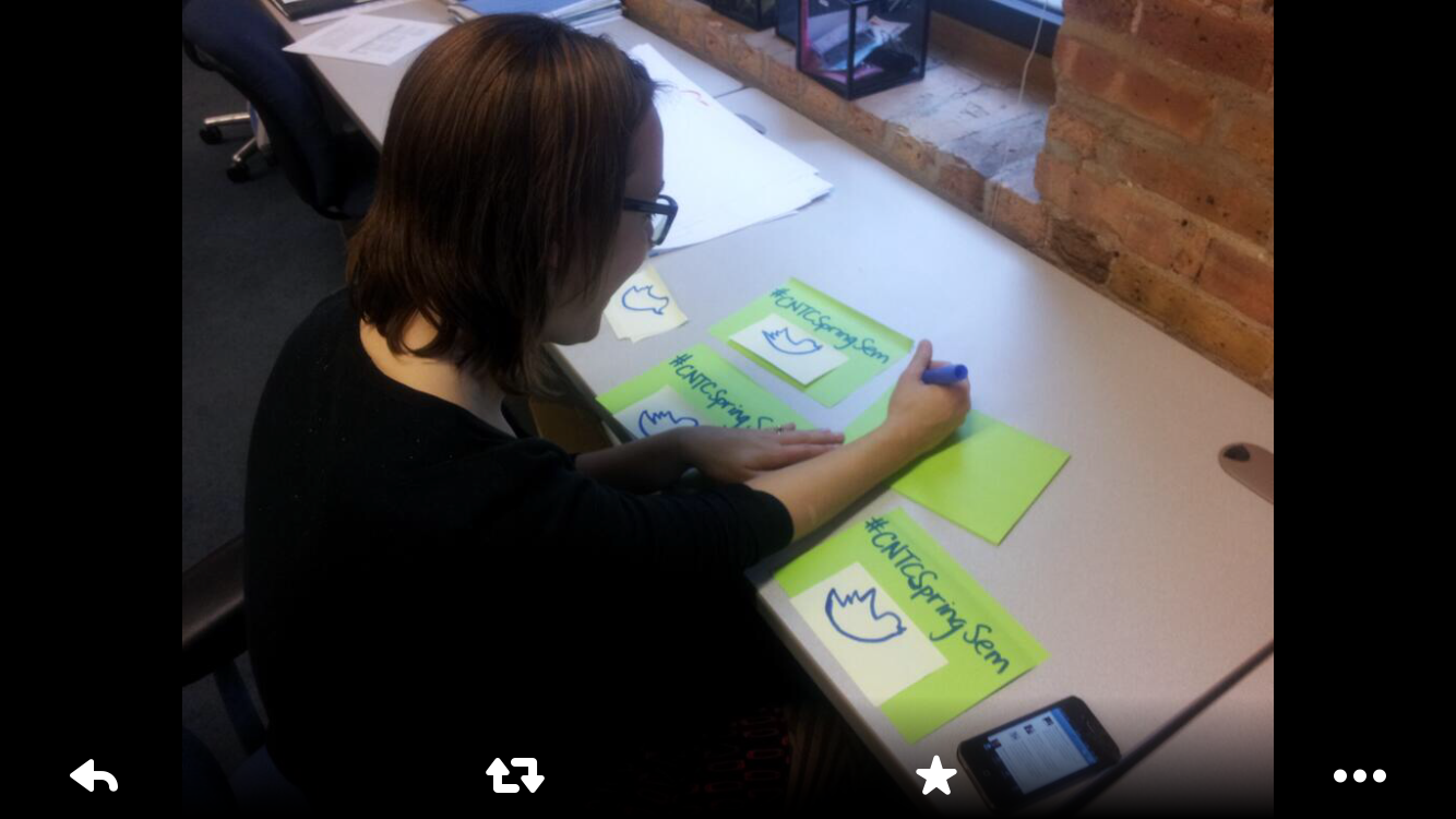 Me preppring a hashtag poster to motivate and remind teachers at a professional workshop to tweet to continue the learning.