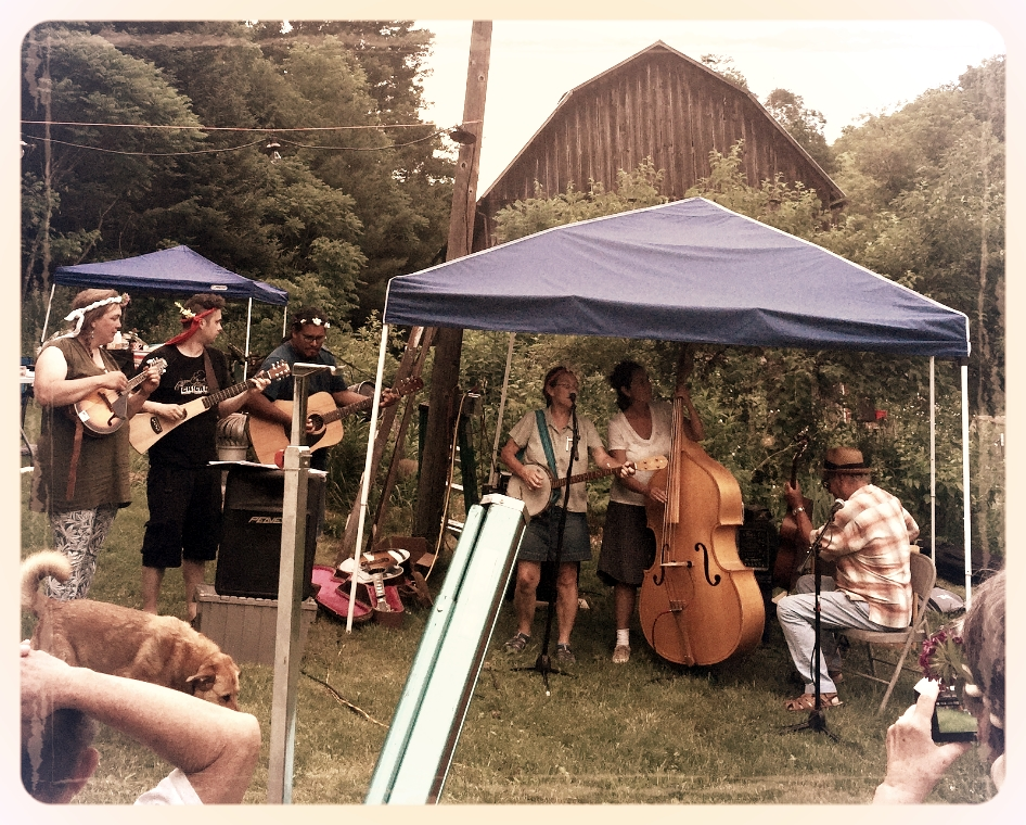 julia and Mauricio's Farm Wedding. Zack and the newly weds join the band in front of the old barn.