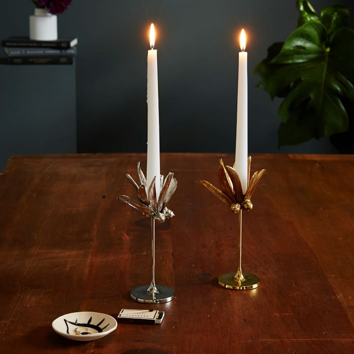 I'm a big fan of tapered candles and their holders, especially for formal, or even informal dining. Instant class.