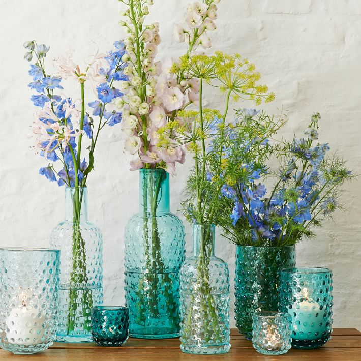 Pretty bottles and vases for simple decorations... on nightstands, in bathrooms, in small corners.