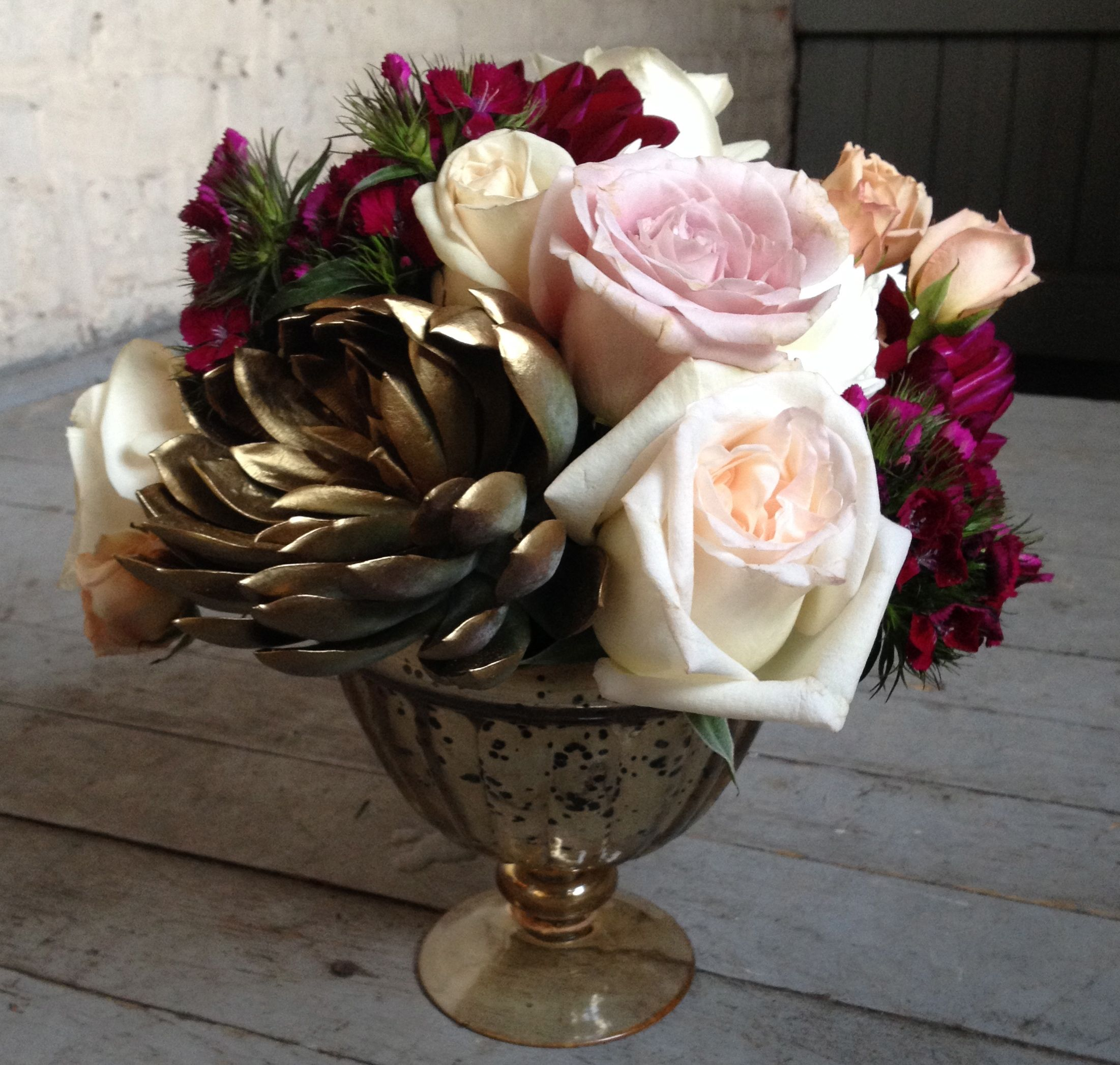 """Notice the gold """"flower""""...it's not a flower but a gold spray painted succulent plant. Cool, huh? The vase is also vintage inspired gold. The inspiration for the flowers (and this blog post!) came from creative director, Megan Moran of  City Girl Weddings ."""