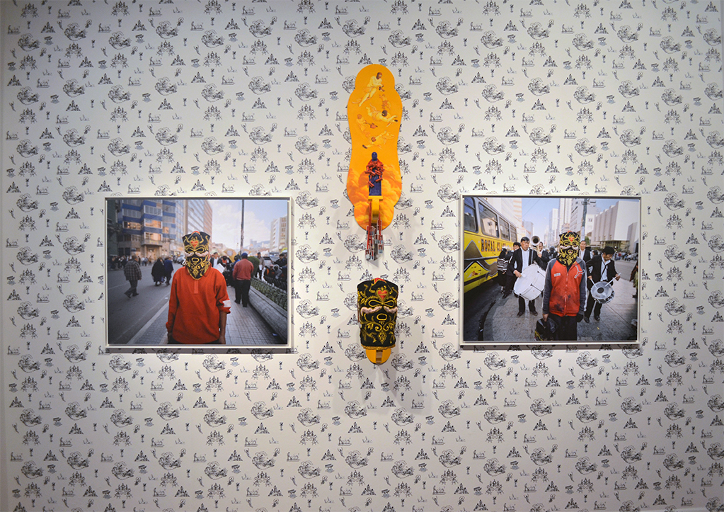 Installation dimension: 165 x 145 inch ( Wall Paper / Mask /Photographs (42 x 24 inch) / Sculpture.