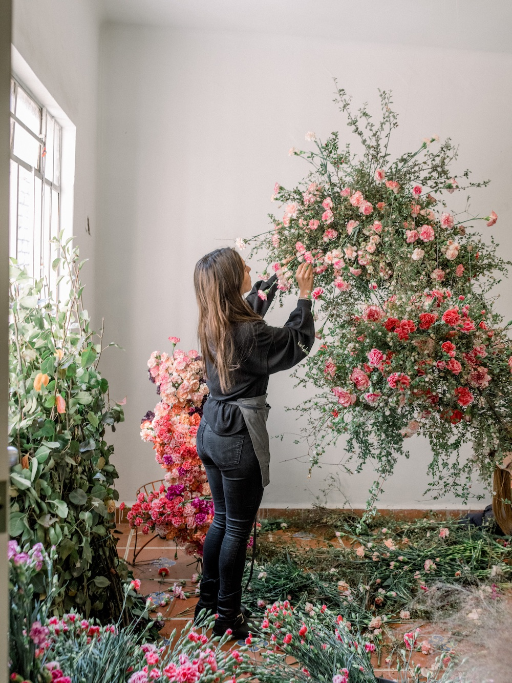 We built a series of floral chandeliers. Here is lovely  Paulina  at work in one of our rooms.
