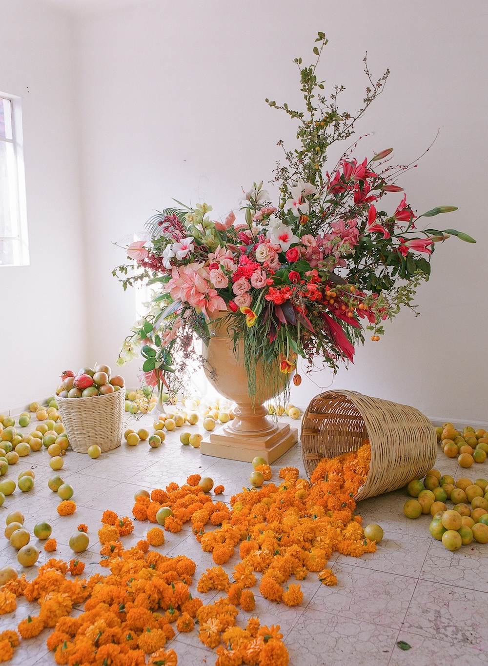 Mexico wouldn't be Mexico without marigolds and bright, bold colors. Lovely  Marianna  and our wonderful house chef  Coco  brought me all of the citrus for this color filled installation in one of the rooms.