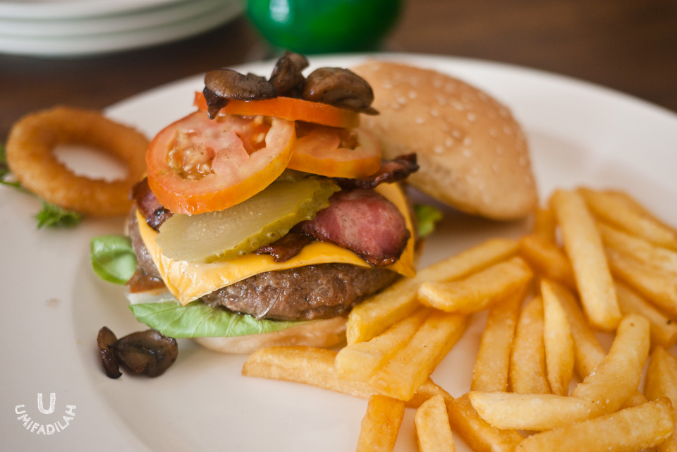 Gastro Burger (IDR 63.000)  - beef patty, bacon, cornichons (small pickled gerkins), tomato, butterhead lettuce, BBQ sauce, french fries, mushroom, and monterey jack cheese.