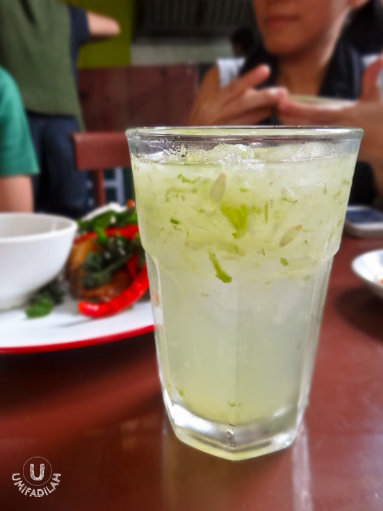 Es Timun.  The iced cucumber beverage I know, uses Pandan syrup or sometimes Melon syrup to sweeten the drink. I'm not sure what they use in Atjeh Rayeuk, but for me it lacks sweetness (see that pale color?).